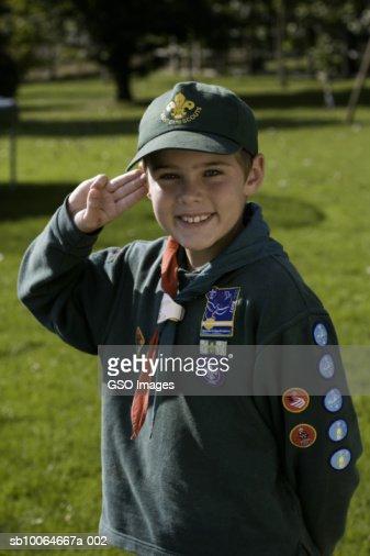 Boy Wearing Cub Scout Uniform Saluting Smiling Portrait