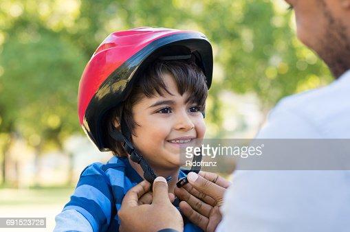 Boy wearing cycle helmet : Stock Photo