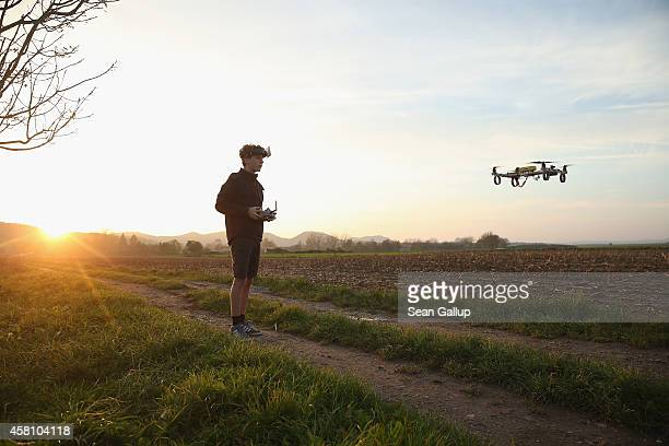 A boy wearing first person view goggles flies a quadcopter drone he built himself on October 24 2014 near Rathen Germany Inexpensive drones used for...