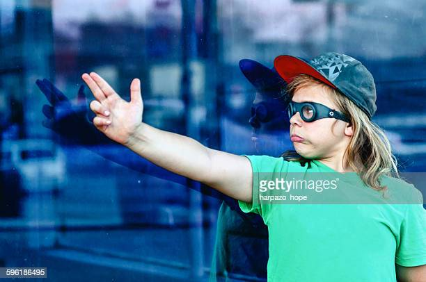 Boy wearing goggles and pointing his finger