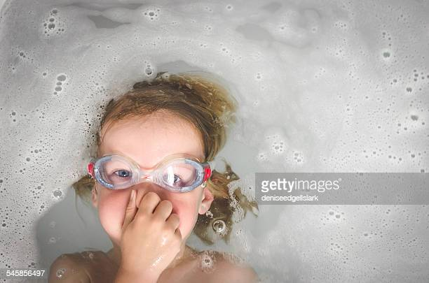 Boy wearing goggles in the bath