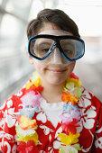 Boy (10-11) wearing Hawaiian shirt and scuba mask, indoors, portrait