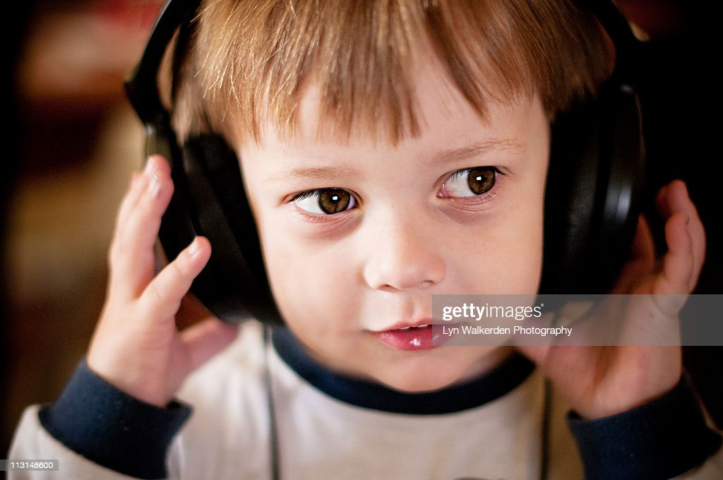 Boy wearing headphones : Stock Photo