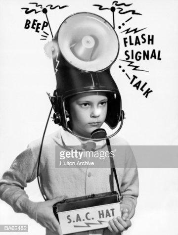 Boy (7-9) wearing 'loudspeaker' helmet (B&W) : Stock Photo