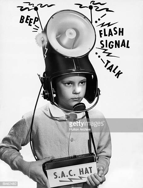 Boy (7-9) wearing 'loudspeaker' helmet (B&W)
