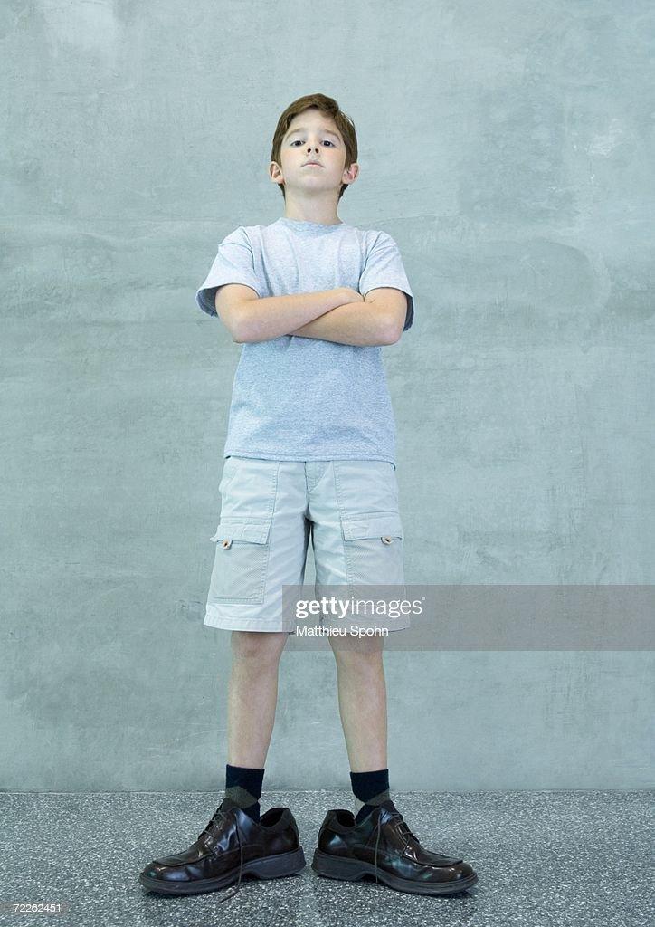 Boy wearing men's dress shoes