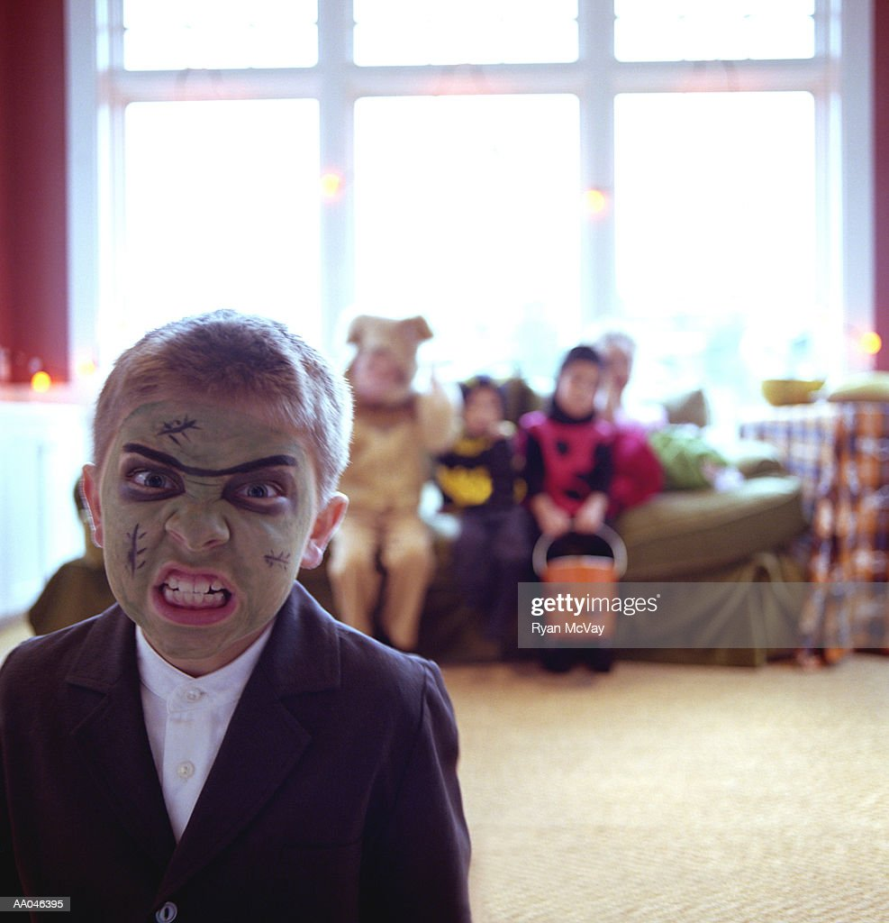 Boy (6-8) wearing monster costume, making a face, portrait : Stock Photo