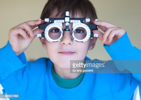 Boy wearing opticians glasses : Stock Photo