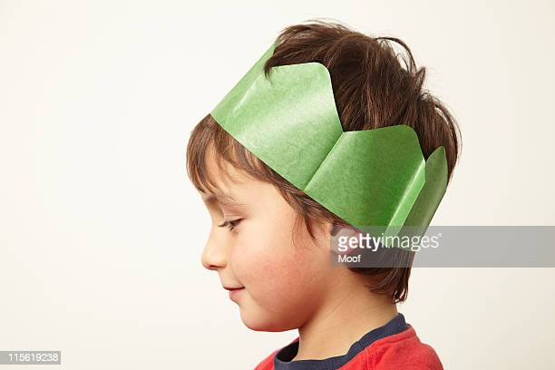 Boy wearing paper crown hat at Christmas