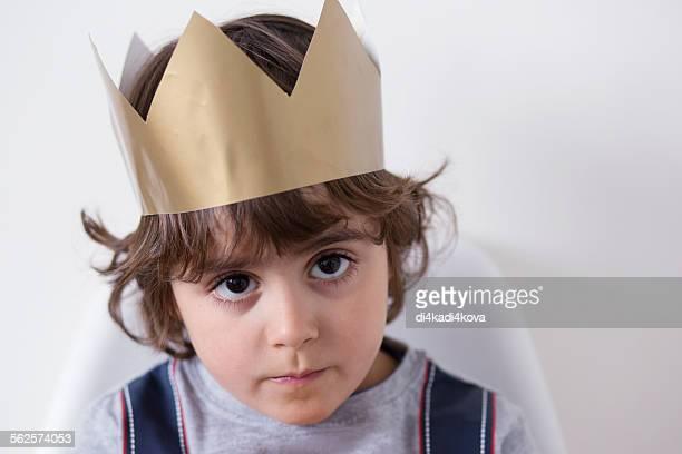 Boy wearing paper crown