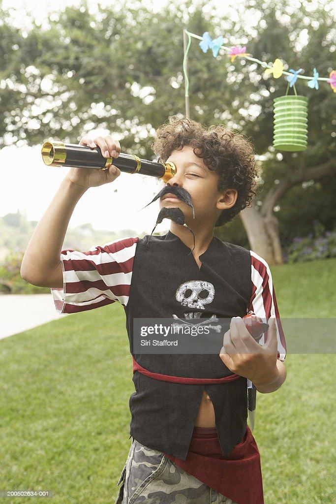 Boy (7-9) wearing pirate costume : Stock Photo