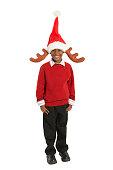 Boy (5-7) wearing Santa hat and antlers, smiling, portrait