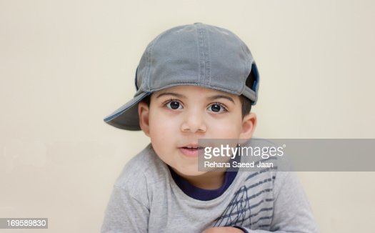 Boy wearing side cap : Foto de stock