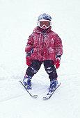 Boy (4-6) wearing ski suit