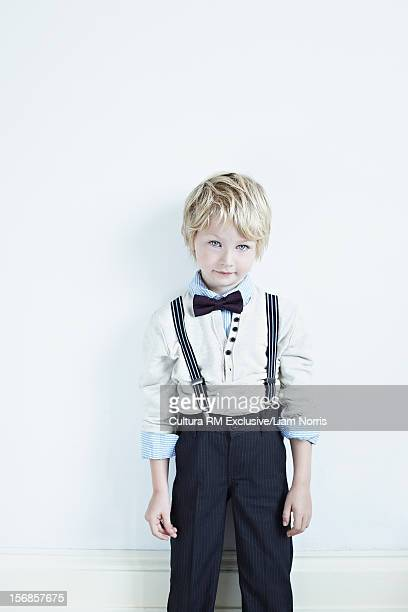 Boy wearing suit indoors