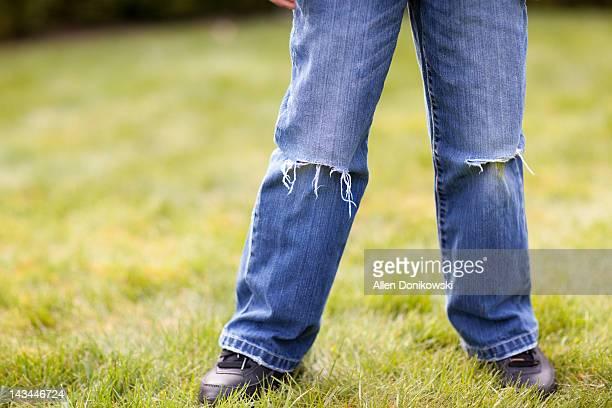 Boy wearing torn jeans