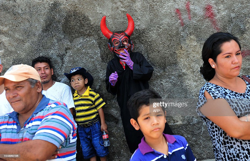 A boy wears a costume during the 'Torovenado' carnival held in the framework of San Jeronimo celebrations, the patron saint of Masaya, 30 km from Managua, on October 28, 2012. The festivities honouring San Jeronimo - which are known as the longest festivities in Nicaragua - began September 20 and end the last Sunday of November. AFP PHOTO/Hector RETAMAL