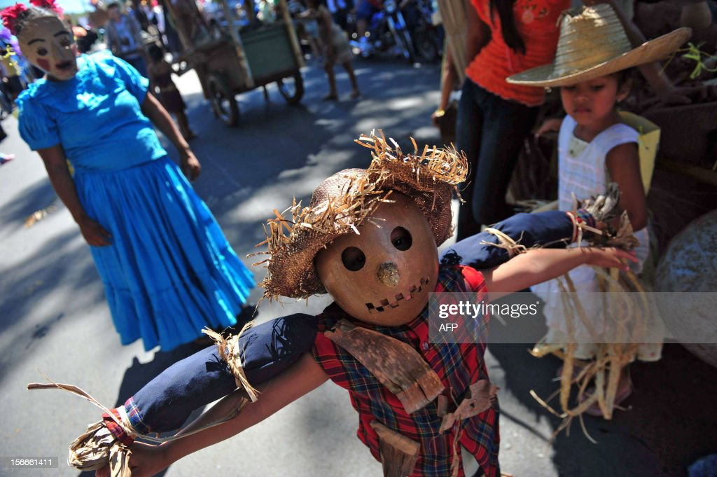 A boy wears a costume during the 'Torovenado' carnival in the framework of the celebrations honouring Saint Jerome, the patron saint of Masaya, 30 km from Managua, on November 18, 2012. The festivities honouring Saint Jerome - the longest festivities in Nicaragua - began on September 20 and will end the last Sunday of November. AFP PHOTO/Hector RETAMAL