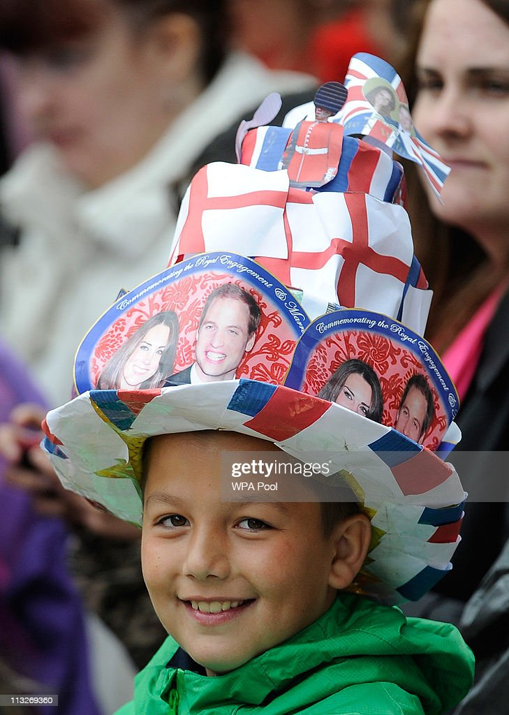 A boy wears a hat with pictures of Britain's Prince William and Catherine Middleton during their wedding ceremony at Westminster Abbey on April 29, 2011 in London, England. The marriage of the second in line to the British throne was led by the Archbishop of Canterbury and was attended by 1900 guests, including foreign Royal family members and heads of state. Thousands of well-wishers from around the world have also flocked to London to witness the spectacle and pageantry of the Royal Wedding.
