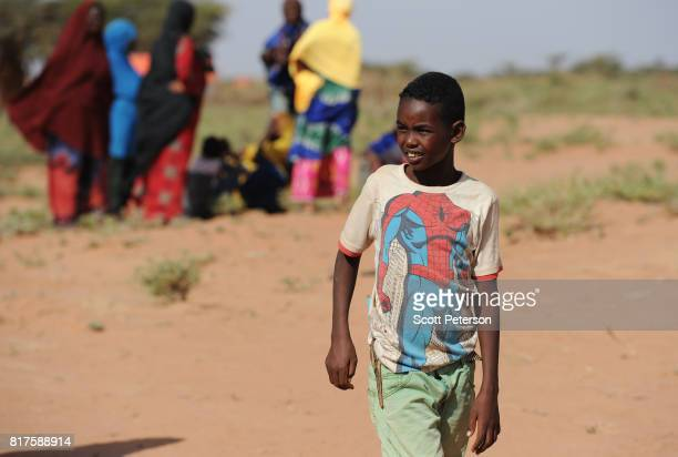 A boy wears a Spiderman Tshirt as Somali families displaced by severe drought gather at a makeshift camp as the Horn of Africa faces severe drought...