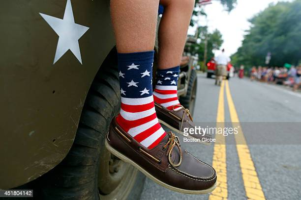 A boy wears American flag socks as he rides in the Fourth of July Parade in Manchester By The Sea Mass July 2 2014