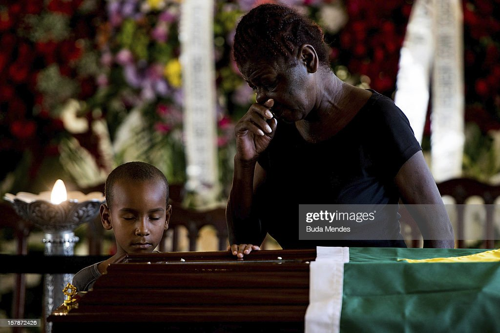 A boy who did studies about the Architect Oscar Niemeyer attends his funeral at Palacio City on December 07, 2012 in Rio de Janeiro, Brazil. Niemeyer was hospitalized for 33 days at Samarian Hospital and died at 104 years old due to a kidney infection on December 06, 2012 in Rio de Janeiro, Brazil.