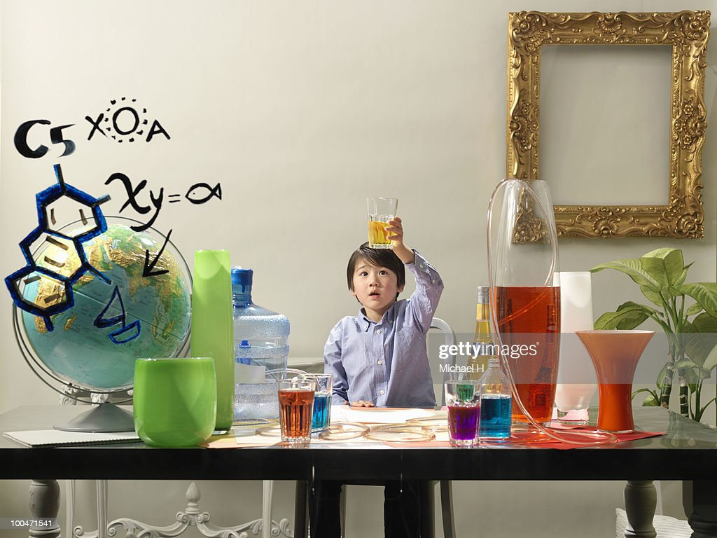 Boy who is experimenting : Stock Photo