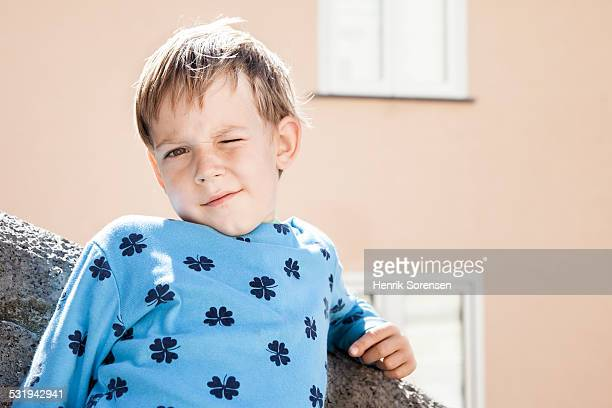 Boy winking and smiling