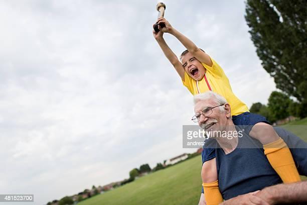 Boy winning a soccer tournament at school