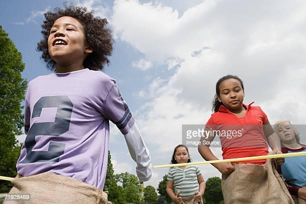 Boy winning sack race