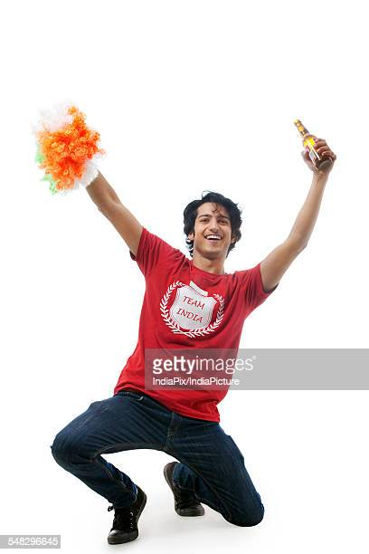Boy with a beer bottle cheering