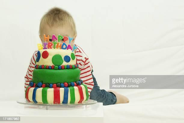 A boy with a birthday cake