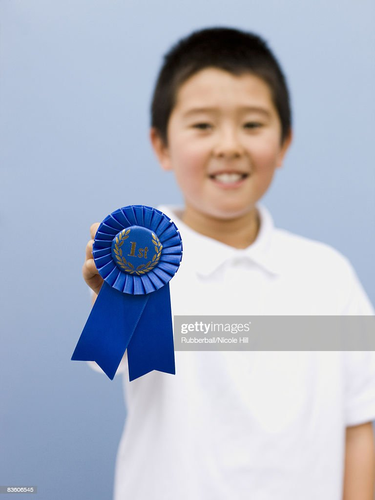 boy with a blue ribbon : Stock Photo