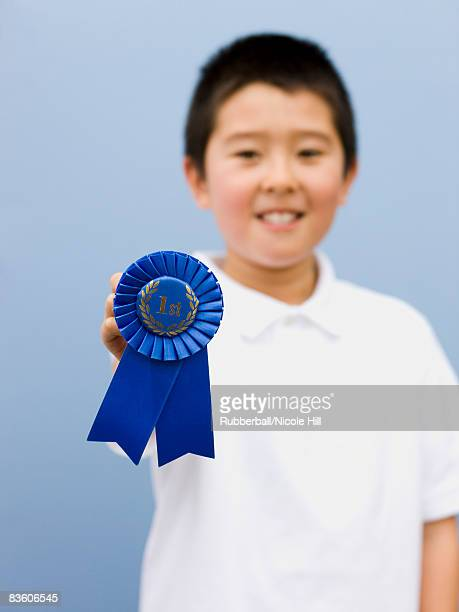 boy with a blue ribbon