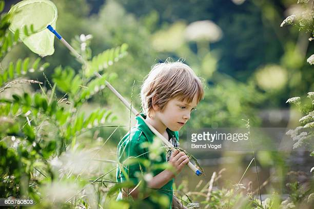 boy with a brailer at a lake