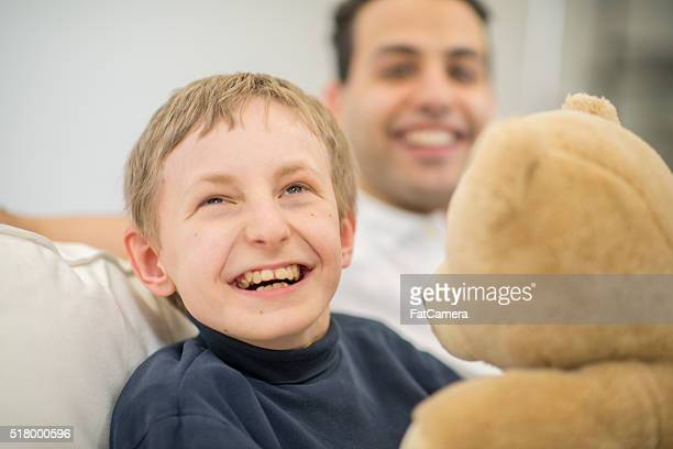 Boy with a Mental Disability with His Caregiver