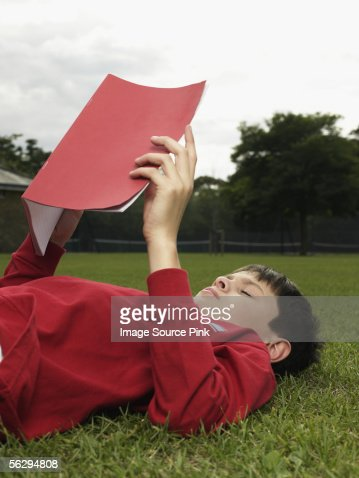 Boy with a notebook in park : Stock Photo