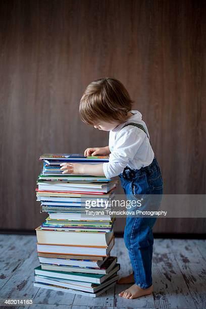 Boy with a pile of books