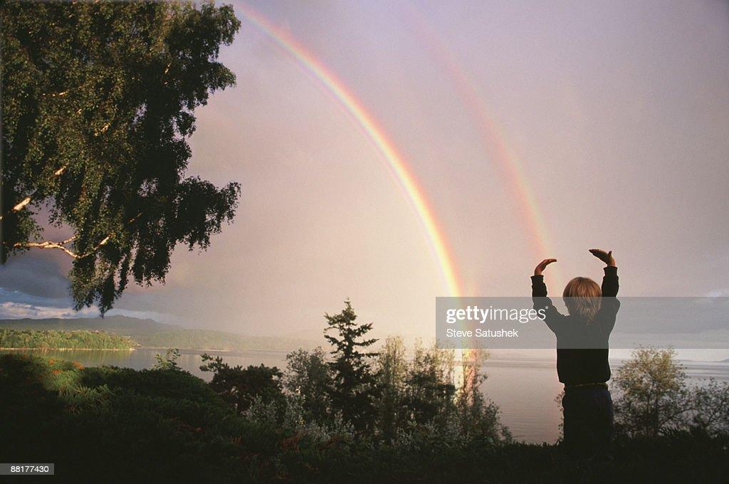 Boy with a rainbow : Stock Photo