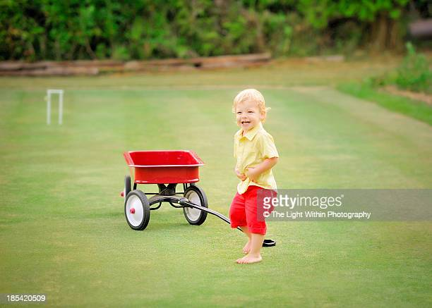 Boy with a red wagon