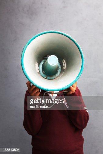 Boy with a speaker in front of his face : Bildbanksbilder