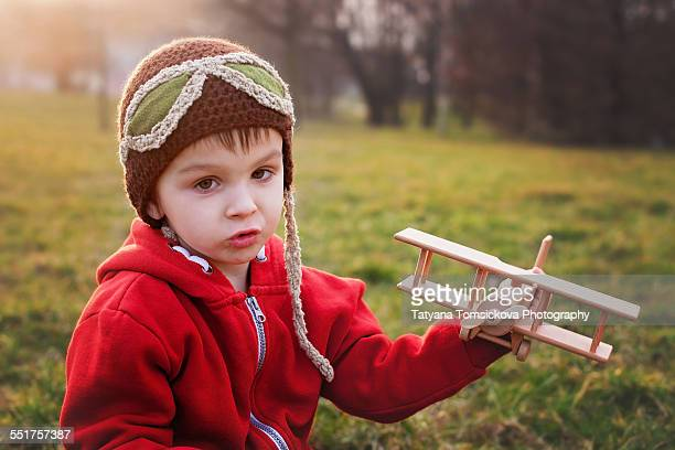 Boy with airplane in the park