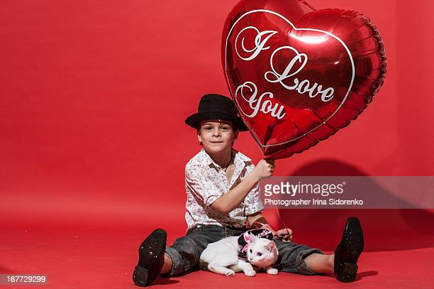 Boy with balloon on red background