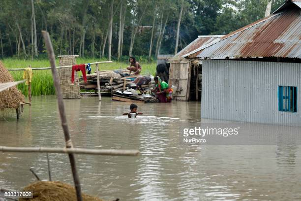 A boy with banana boat moves to other place for continuous flooding in Sariakandhi area at Bogra Bangladesh 16 August 2017 Peoples suffering...