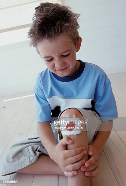 Boy with bandage on knee