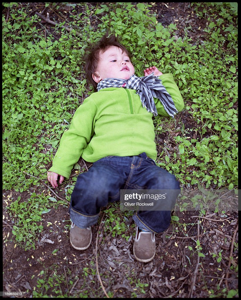 A boy with blurry knees : Stock Photo