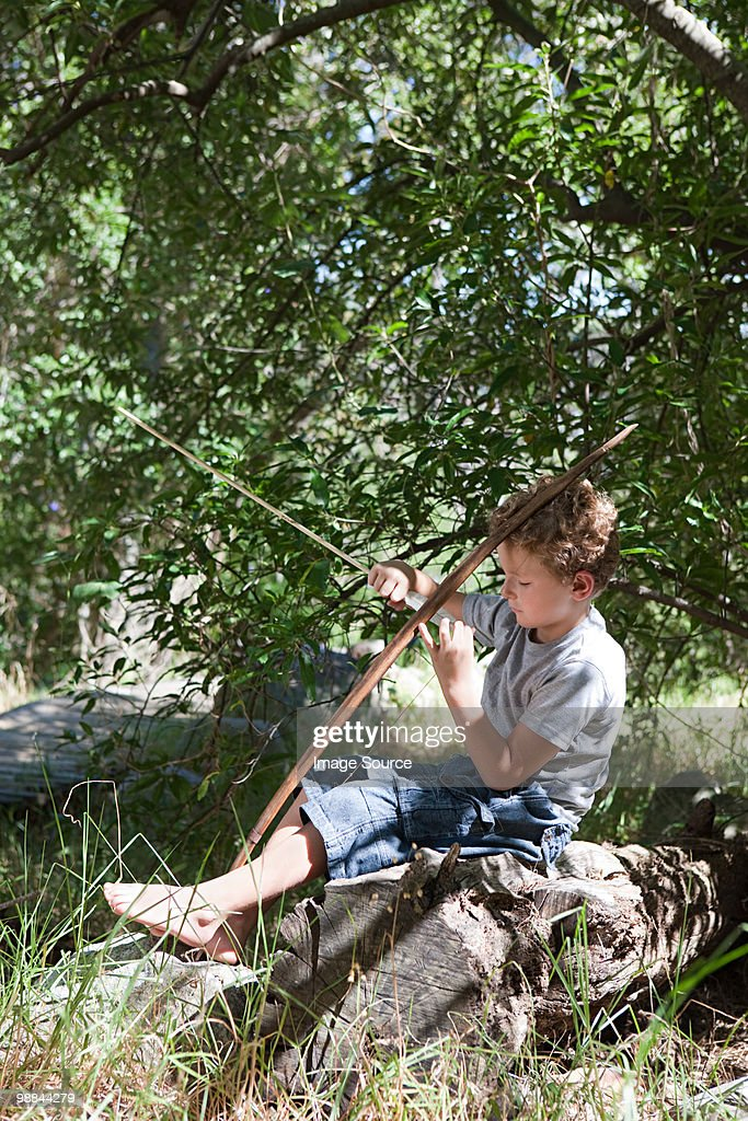 Boy with bow and arrow : Stock Photo