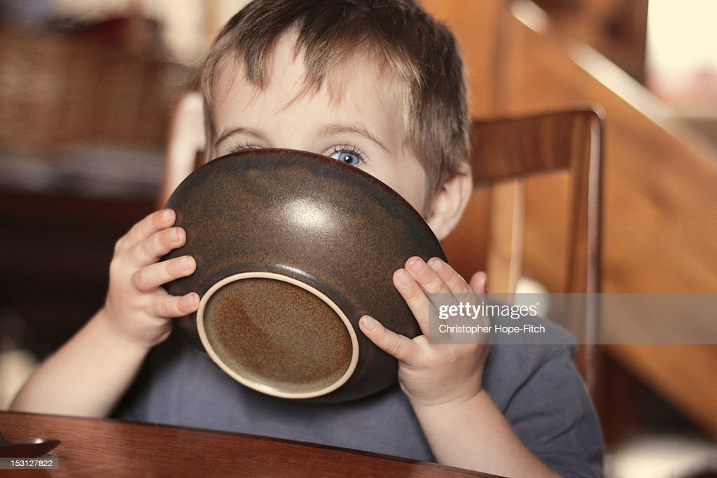 Boy with bowl : Stock Photo