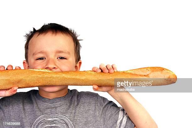 Boy with bread.