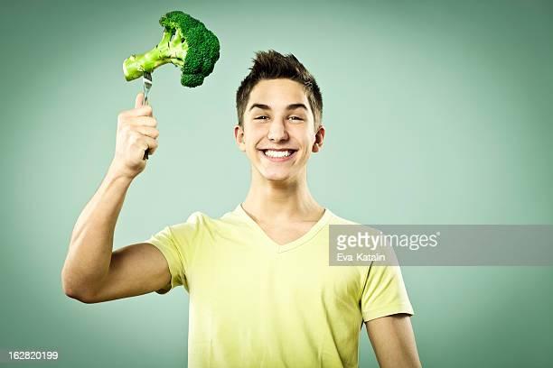 Boy with broccoli